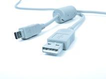 Cable del USB en tono azul Fotografía de archivo