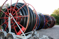 Cable drums. Red cable drums with black cable Stock Photos