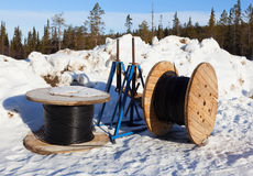 Cable drums in the snow Stock Photos