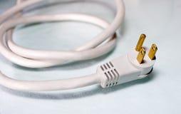 Cable eléctrico blanco para el ordenador Foto de archivo libre de regalías