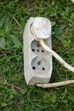 Cable eléctrico de la extensión con el zócalo Imagen de archivo