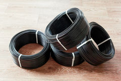 Cable eléctrico negro Imagen de archivo