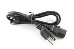 Cable eléctrico negro aislado en un fondo blanco Fotos de archivo libres de regalías