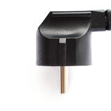 Cable eléctrico negro del ordenador aislado sobre el fondo blanco Imágenes de archivo libres de regalías