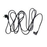 Cable eléctrico negro del ordenador aislado sobre el fondo blanco Foto de archivo libre de regalías
