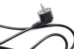 Cable eléctrico negro del ordenador aislado sobre el fondo blanco Imagen de archivo libre de regalías