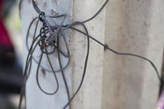 Cable eléctrico, polos de poder Fotografía de archivo