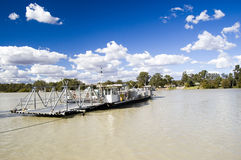 Cable Ferry. (also called floating bridge or chain ferry) crossing the River Murray at Mannum, South Australia. Blue sky and white clouds Stock Images