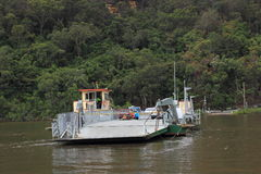 Cable ferry passing river Royalty Free Stock Images