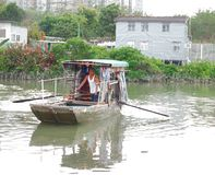 Cable Ferry in Pond in Traditional Fishing Village stock images