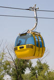 Cable gondola car. Cable gondola car above trees Stock Images