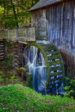 Cable Grist Mill in Cades Cove in the Great Smoky Mountains in Tennessee. Water still flows and still turns the wheel in the century plus old Cable Grist Mill in Stock Photos