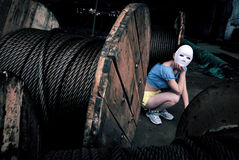 Cable group and the masked girl Stock Photos