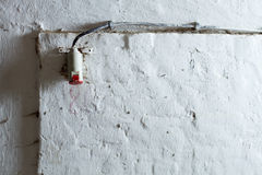 Cable on grunge wall Stock Photos