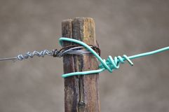 Cable with knot. Old cable with knot on a wood pillar Stock Photography