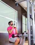 Cable Lat pulldown machine man workout at gym Royalty Free Stock Image