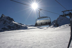 Cable lift. A cable lift in a high snowy glacier ski region royalty free stock photography