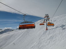 Cable lift. Orange bulbs of the ski-lift Royalty Free Stock Photography