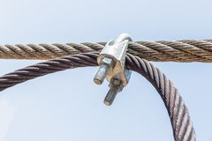 Cable linked. Wire rope binding. Cable linked together by steel clamp stock image