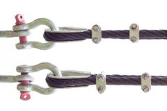 Cable linked. Wire rope binding. Cable linked together by steel clamp stock photo