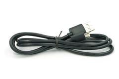 Cable micro del usb en el fondo blanco Imágenes de archivo libres de regalías