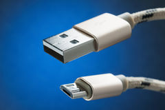 Cable micro-USB to USB connector. blue background Royalty Free Stock Image