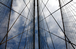 Cable Patterns On Brooklyn Bridge. These cables perfecly form many triangle patterns, with the blue and cloudy sky as the background Stock Image