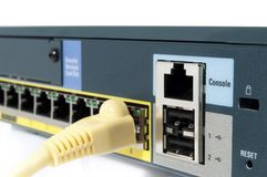 Cable plugged in. Yellow cable plugged in an ehternet firewall Stock Photography