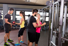 Cable pulley system gym and dumbbell fitness people Stock Photos