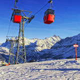 Cable railway on winter sport resort in swiss alps Stock Images