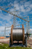 Cable reel in front of power lines Stock Images