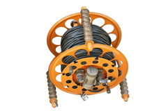 Cable reel for mobile working. Electric extension prong and reel isolated over white background Stock Photography