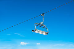 Cable ski chair against blue sky Royalty Free Stock Photo