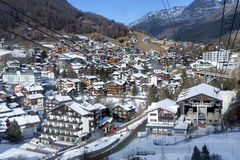 Cable ski lifts on the background of the most popular ski resort of Saas-Fee Stock Image