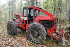 Cable skidder. Heavy vehicle used in a logging operations for pulling cut trees out of a forest Royalty Free Stock Image