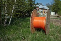 Cable on spool. Orange cable on wooden spool Stock Image