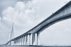 Cable-stayed bridge. Under blue sky royalty free stock photo