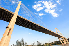 Cable-stayed bridge. A bridge linking the two sides, it looks like a cross Royalty Free Stock Images