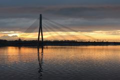 The cable-stayed bridge across the Daugava River in Riga during sunset stock photos