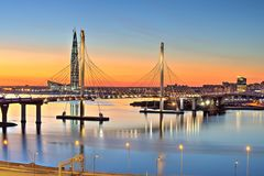 Cable-stayed bridge across Petrovsky waterway at sunset, St. Pet Royalty Free Stock Photography