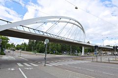 Cable-stayed bridge across the street in Helsinki. HELSINKI, FINLAND - JULY 11, 2015: Cable-stayed bridge across the street in Helsinki Royalty Free Stock Images