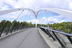 Cable-stayed bridge across the street in Helsinki. HELSINKI, FINLAND - JULY 11, 2015: Cable-stayed bridge across the street in Helsinki Royalty Free Stock Image