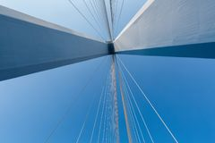 Cable-stayed bridge closeup. Against a blue sky , abstract structure background Royalty Free Stock Photo