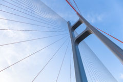 The cable stayed bridge closeup. Cable stayed bridge closeup against blue sky , upward view stock photo