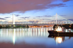 Cable stayed bridge at night. Cable-stayed bridge with illumination across the Neva River in St.Petersburg, Russia Royalty Free Stock Photography