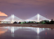 Cable stayed bridge at night. Cable-stayed bridge with illumination across the Neva River in St.Petersburg, Russia royalty free stock photo