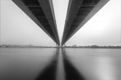 Cable-stayed bridge over river in fog. black and whito photo. bw bridge Royalty Free Stock Photos
