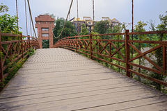 Cable-stayed bridge with planked deck and rusted h Stock Image