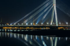 Cable-stayed bridge and River Daugava at night, Riga, Latvia Stock Images
