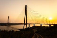 Cable-stayed bridge `Russky Bridge` to island Russkiy on the sunset. Vladivostok, Primorsky Krai, Russia.  stock images